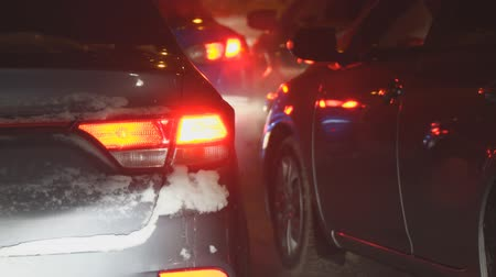 multiple lane : Cars in traffic in winter at night Stock Footage