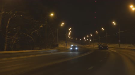 srážky : Driving on the night road in winter