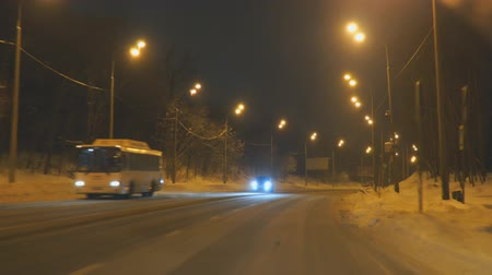 srážky : Samara, Russia - January 30, 2019: Cars drive on the night winter road