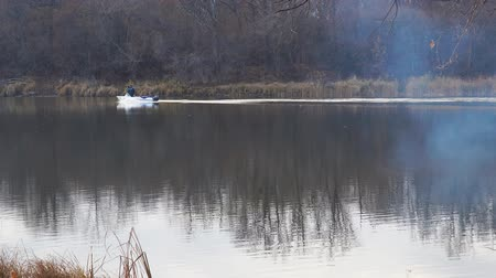 small vessels : Motor boat floats on the autumn lake