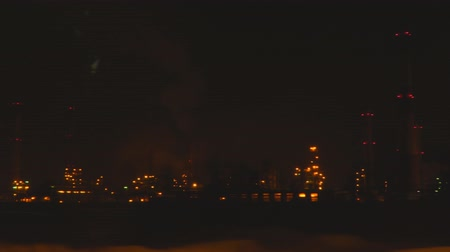 petroleum refinery : View of the oil refinery at night from the car window Stock Footage