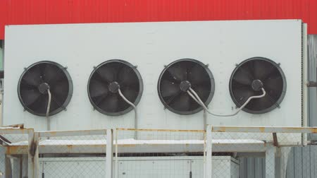 refrigerant : Industrial air conditioning system. Large fans on the wall of the building