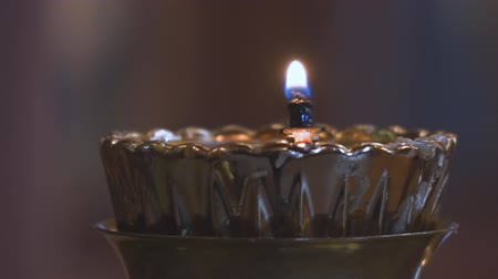 pastor : A small candle in a Church candlestick in the Orthodox Church Stock Footage