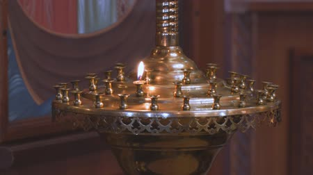 titular : A small candle in a Church candlestick in the Orthodox Church Stock Footage