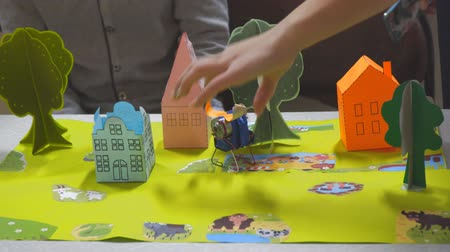 contraction : Orange house and green tree made of paper. Childrens paper crafts. Soft focus