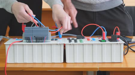 disjuntor : Engineers connect wires control panel or Electrical training device Vídeos