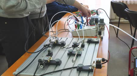 disjuntor : Engineers connect wires control panel with a small test bench for experiments