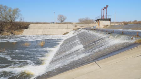 hidrolik : Water flows through the dam on the river
