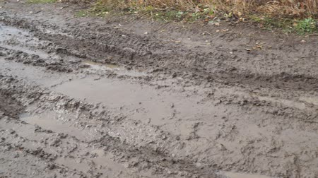 A slippery, impassable, muddy country road in the autumn season. Offroad