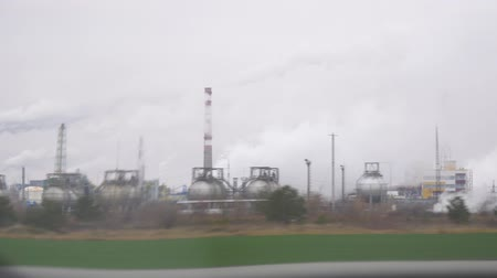 View of the chemical plant from the window of a passing car on the road