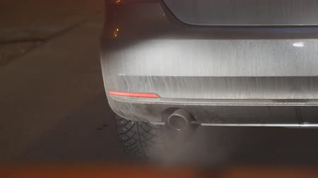 hangtompító : Smoke from the cars exhaust pipe. Environmental pollution