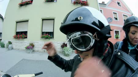 couro : Close up on motorcycle driver putting on protection glasses