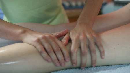 masaż twarzy : Close up of massaging woman legs with body care therapy