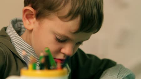 preschool : Close up of young kid enjoying drawing in kindergarten Stock Footage