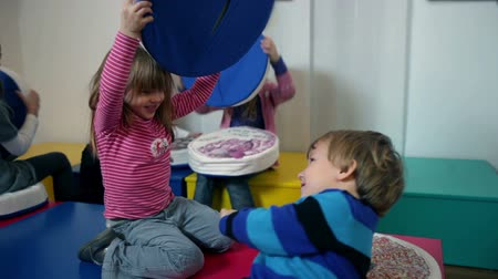 preschool : Kids playing in kindergarten with pillows