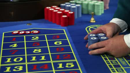 рулетка : Young man winning at roulette in casino