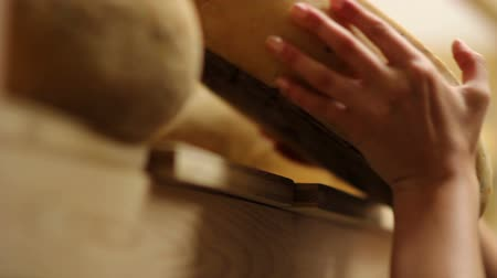 cheese piece : HD1080p: Close up of womans hand moving cheese with changing focus