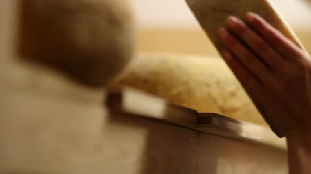pieces of cheese : HD1080p: Close up of womans hand taking cheese with changing focus