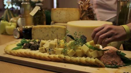 cheese piece : HD1080p: Close up of eating served cheese from board