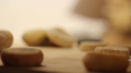 pieces of cheese : HD1080p: Close up of putting small cheeses together