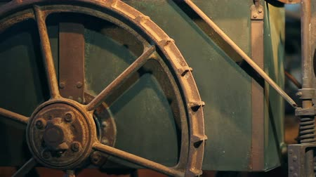 história : HD1080p: Old wheel on a machine as an exposition