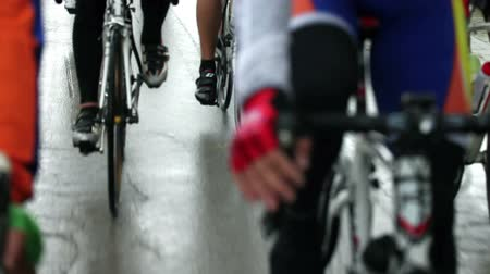 cyclists : Close shot of crowd of cyclists on the road Stock Footage