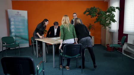 discussion meeting : Wide shot of finished business meeting with young employees Stock Footage