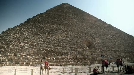 prehistory : Wide shot panning of pyramid and tourists around