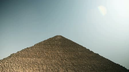 prehistory : Tilting wide shot of pyramid from below