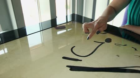 interaktif : Hand drawing love heart on touch screen and jumps away Stok Video