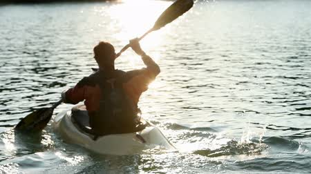 kayak : young people while canoeing on the lake Stock Footage