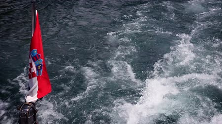 hırvatistan : Shot of the croatian flag on the back side of boat,  while moving Stok Video