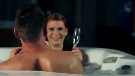 веселье : couple in jacuzzi spending romatic time together