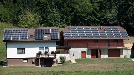 панель : New and old house equiped with solar panels Стоковые видеозаписи