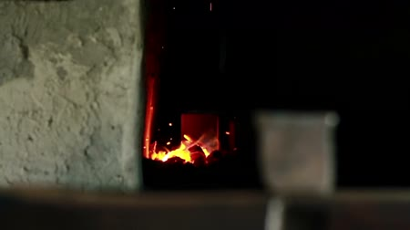 kowal : Close up shot of the furnace with fire and sparkling  Wideo