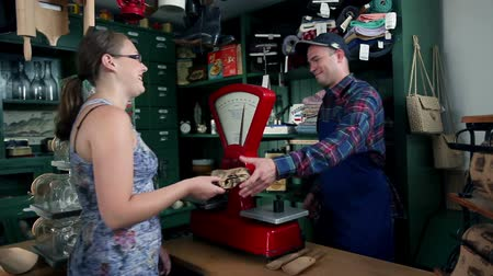 antika : Shot of customers who are buying different things in an old, retro shop Stok Video