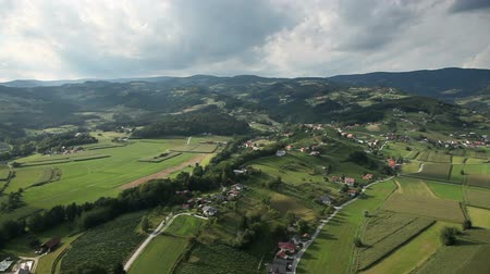 outside view : Shot from helicopter representing  valley with small towns with lots of houses and other infrastructures
