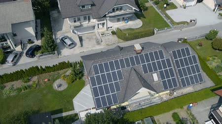 e : Shot from helicopter representing an industrial part of a small town with roofs covered with solar power stations