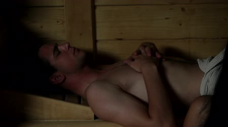 toalhas : HD1080p: Close up of a couple relyxing in sauna Stock Footage