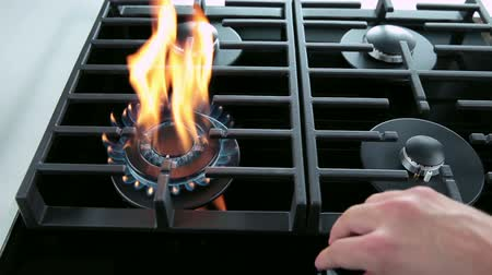 cooktop : Medium shot of turning on and off gas cooker