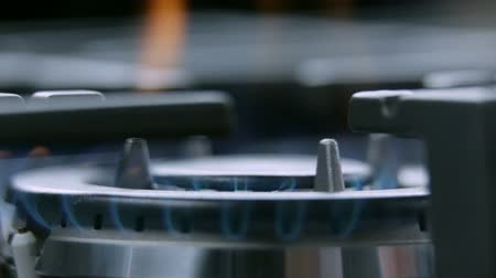 cooktop : Cooktop on fire from close up Stock Footage
