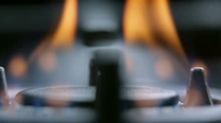 cooktop : Extreme close up panning on gas cooker fire Stock Footage