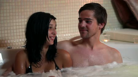 романтика : HD1080p: Shot of a couple laughing and talking in a private jacuzzi