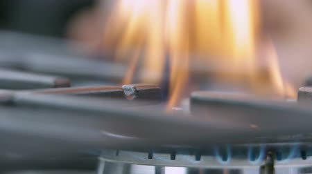 cooktop : Changing the intensity of fire on gas cooker Stock Footage