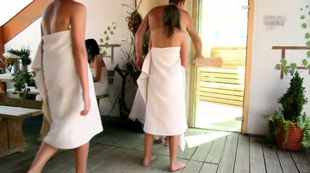 towel : A group of people entering sauna Stock Footage
