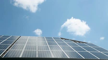 energy generation : Clouds above solar panels on roof