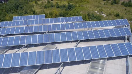 panel buildings : Shot from helicopter representing an industrial part of a small town with roofs covered with solar power stations