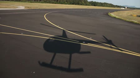 pursuit plane : Shot of a heli shadow on road