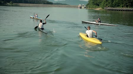 stáří : Group of kayakers competing on lake
