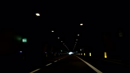 underground tunnel : a road and driving in the dark tunnel